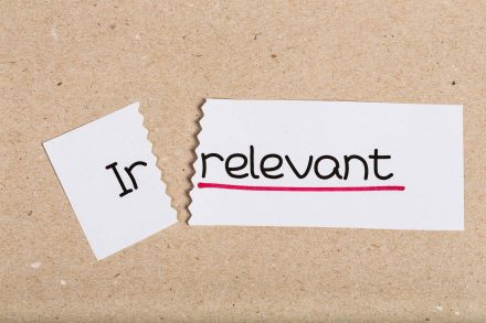 Two pieces of white paper with the word irrelvant turned into relevant