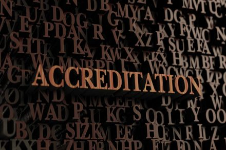 Accreditation - Wooden 3D rendered letters/message.  Can be used for an online banner ad or a print postcard.
